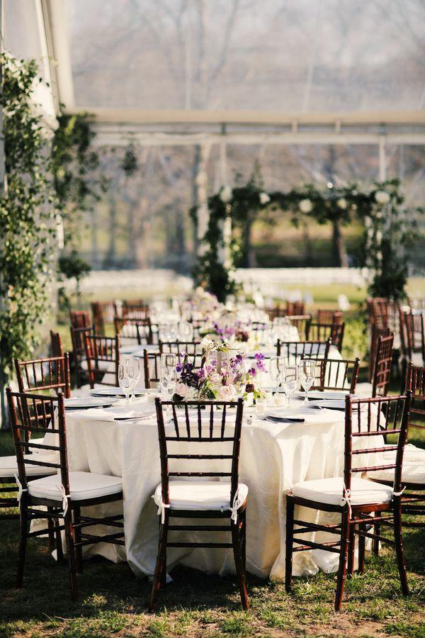 Simple garden reception with floral arch decorations #wedding #gardenparty #outdoorwedding #reception #tablescape
