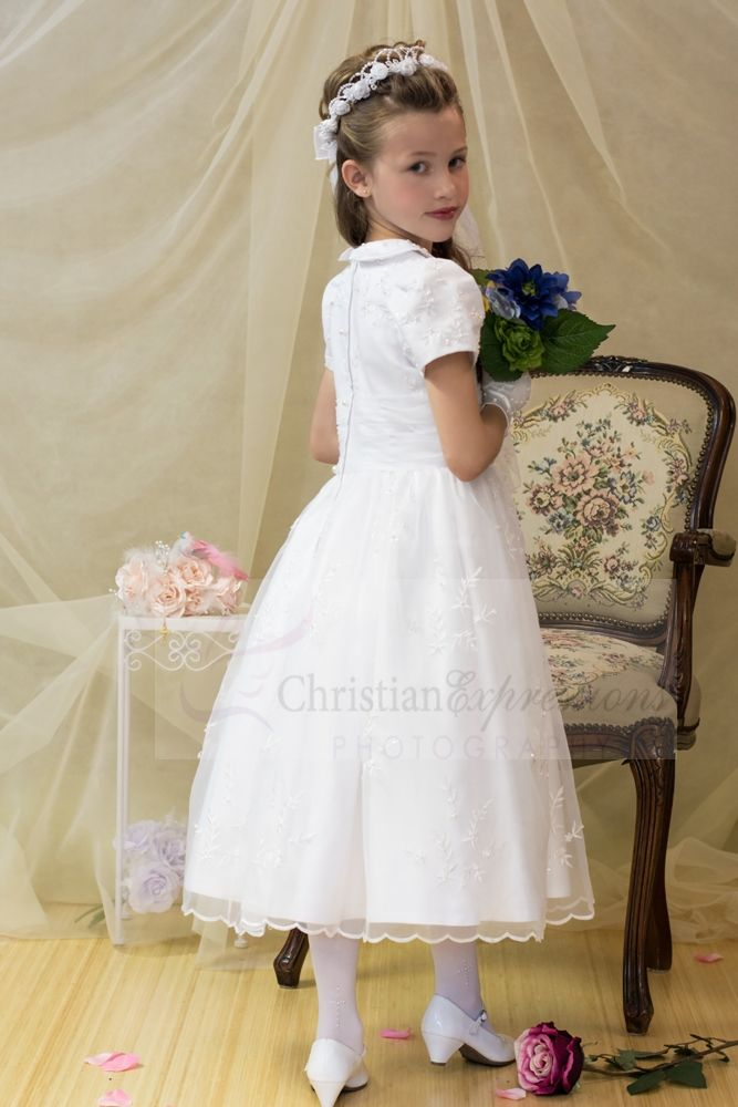 5480251e7d0df Gorgeous short sleeve tea length first holy communion dress with peter pan  collar. Satin with organza overlay with allover embroidery flowers accented  with ...