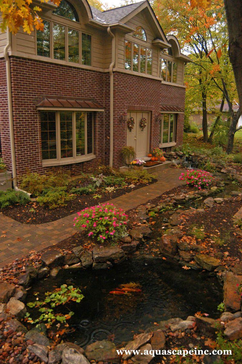 Front garden features  A pond next to the front walkway adds a unique landscape element