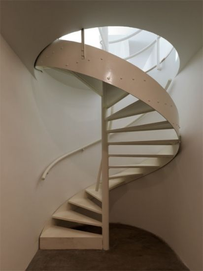 Steel spiral staircase into a technical floor