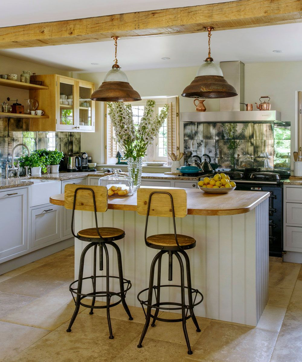a tour around this tranquil, mellow-stoned Cotwold cottage JB- I love this space!!The quaintness of that little island. Inviting anyone to visit.