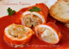 Photo of Stuffed squid with sauce cooked in a pan juicy and tasty