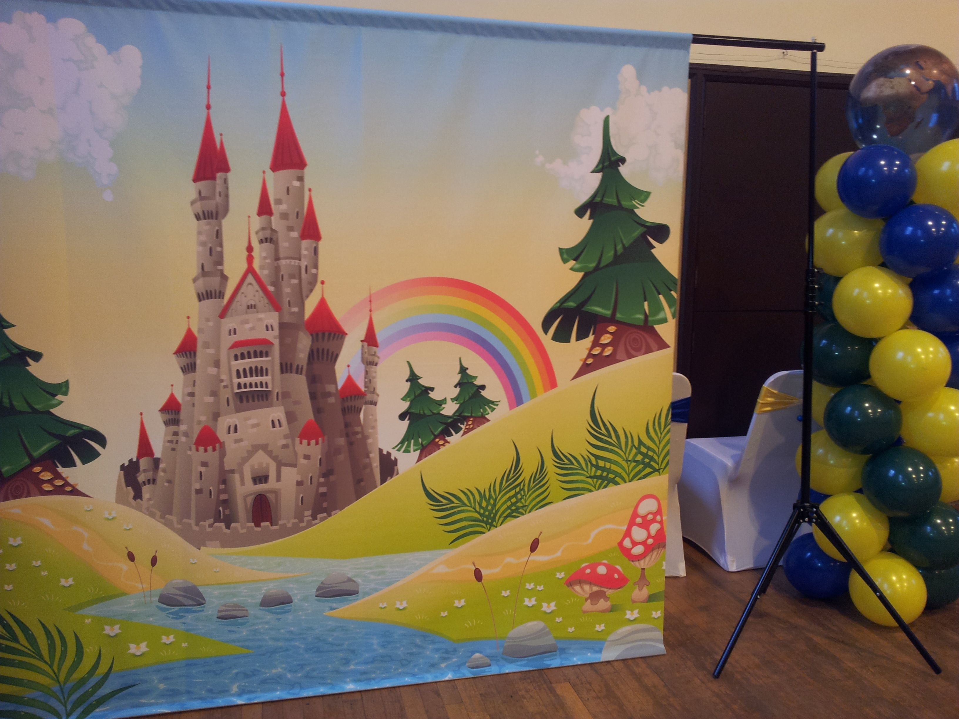 Around the world party balloon column and DIY photo booth backdrop.