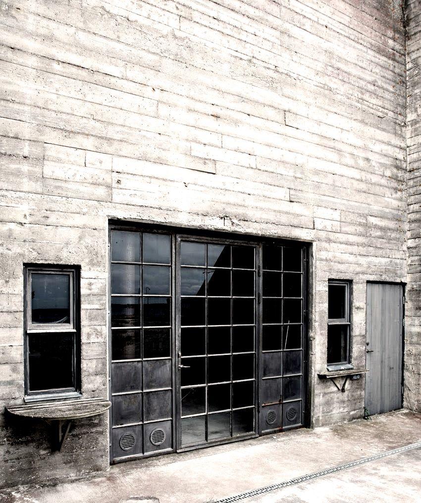 Industrial Metal Windows And Door Set Into A Vast Concrete