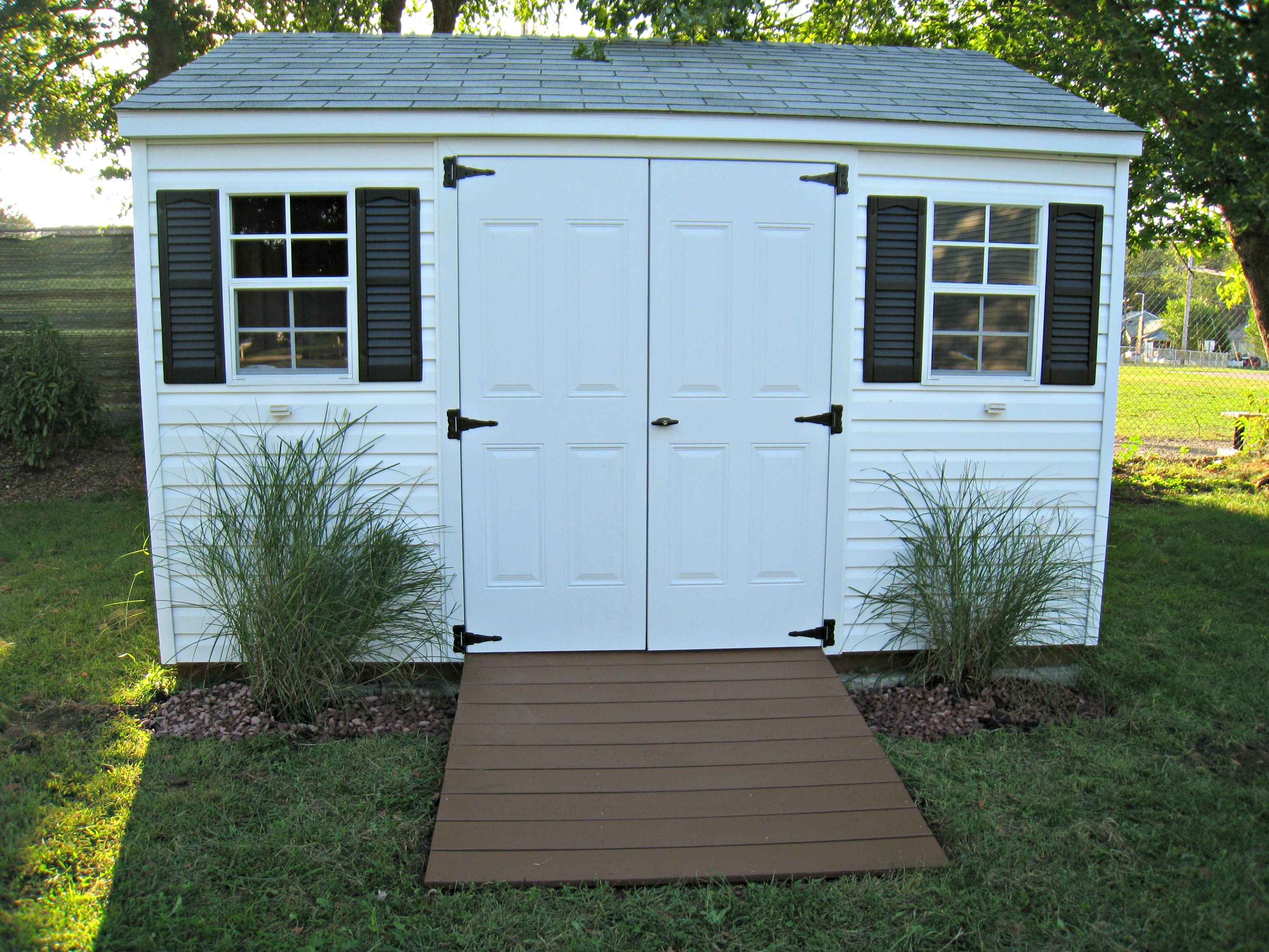 Ramp to storage shed in chocolate with decorative grasses in front