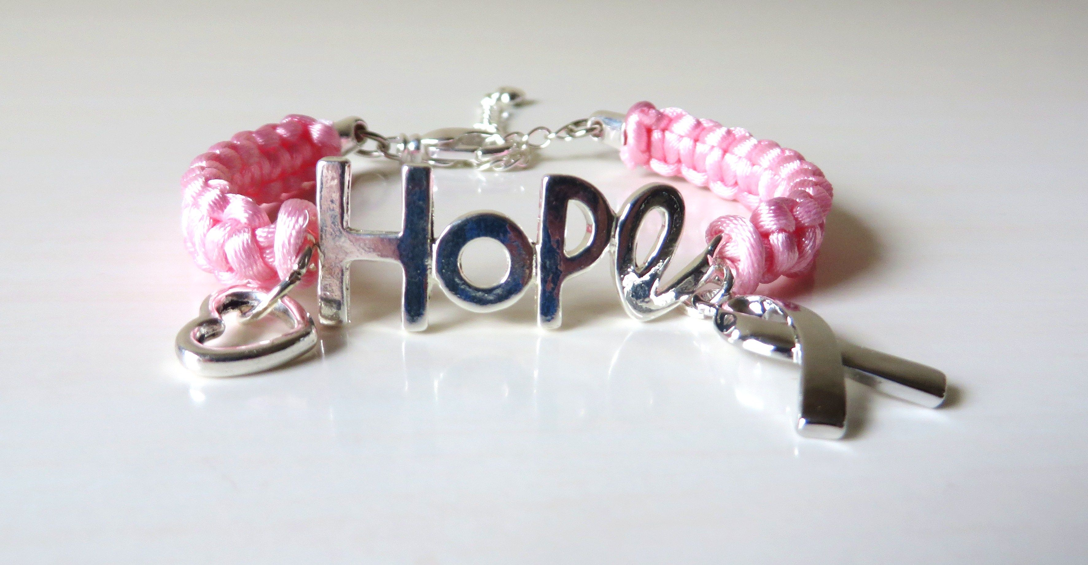 """Pinkk Satin Cord is macramed onto both sides of a """"Hope"""" Bracelet Bar.  Silver-colored Awareness Ribbon Charm and Floating Heart Charm are attached. www.etsy.com/shop/jewelrydesigned4you"""