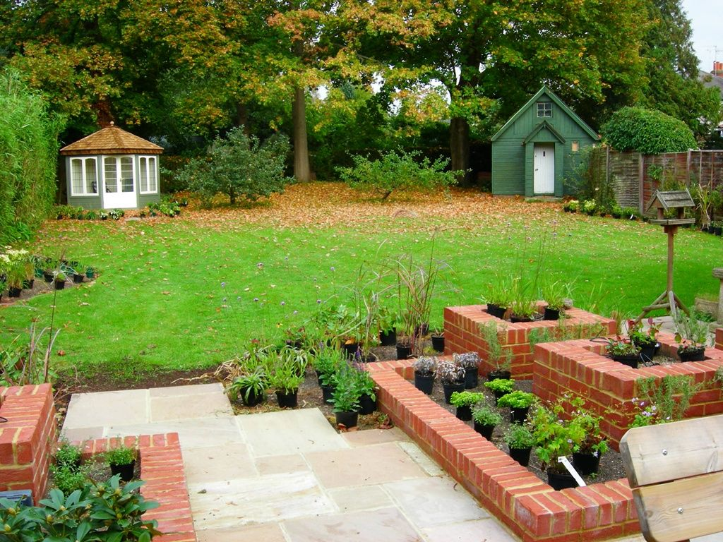 Raised brick planters landscape design ideas pinterest for Backyard planter ideas