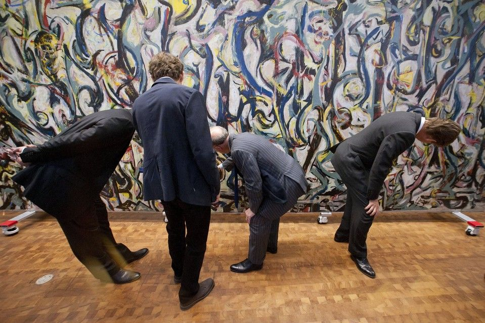 """Two top Getty officials, an artist and a conservation scientist take a close look at Jackson Pollock's 1943 """"Mural"""" at the Getty Center in Los Angeles, Calif."""