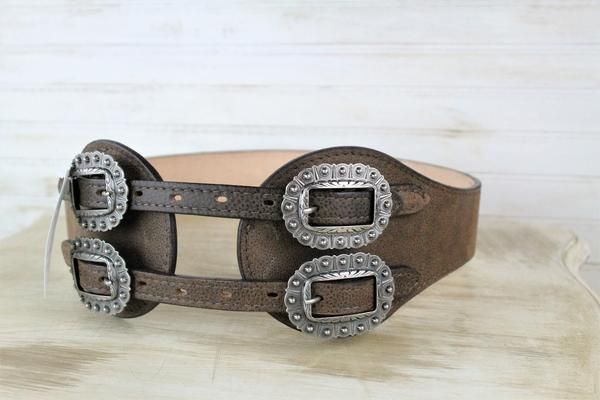 - This belt can be paired easily with western or traditional styles! - 2 inches at the back - Buckle area is 4 inches - 3/4 inch antique silver scallop buckles - Genuine leather \