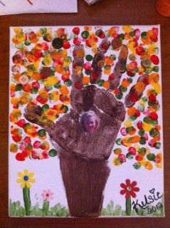 We tried our own handprint tree. We embellished with buttons, felt flowers with rhinestones and a picture in the center of the tree.