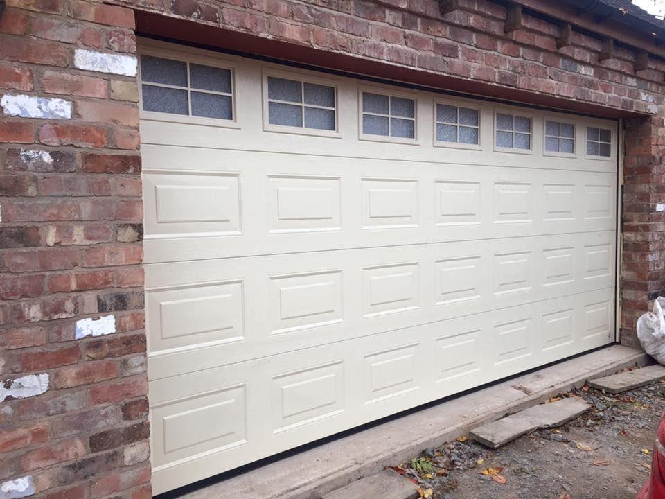 Cream Insulated And Remote Sectional Garage Door With Windows Georgian Garage Door Doors Sectional Garage Doors Garage Doors