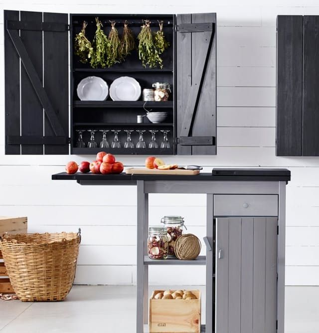 Small kitchen cooks, rejoice! IKEA's newest storage island is designed with you in mind. Adjustable shelves? Check. A cabinet with door and a roomy drawer? Check. A top that extends out on either side to double its size? Oh yes. And hurray for the chic gray and black color combo instead of the standard birch.