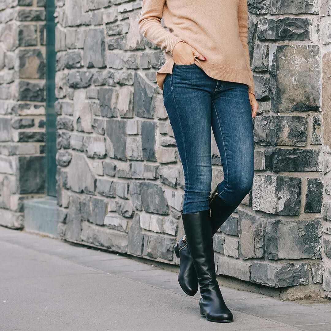 Here's proof that skinny jeans are going nowhere fast. Neatly tucked into The Chain Boot (our only new riding boot style for Fall 2015), pair your favourite blues with a cozy knit sweater. Consider the unique chain detail on the heel an effortless accessory as a draped turtleneck replaces your favourite statement necklace. Our Poppy Barley take on Fall fashion is live via the link in our profile  poppybarley.com/magazine #ShoesToLiveBy #fallfashion2015