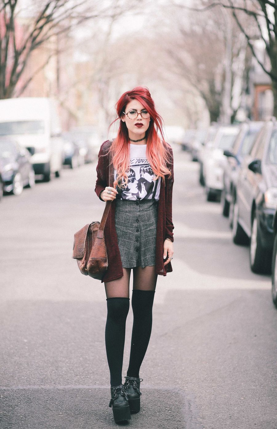 Le Happy wearing Sonic Youth tee and grey plaid skirt