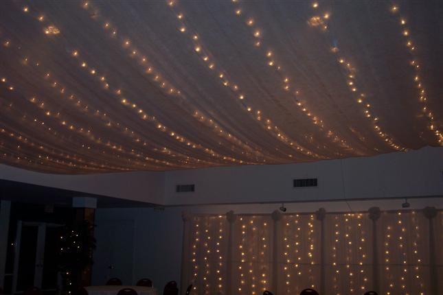 Wedding reception lighting Tulle and white christmas lights