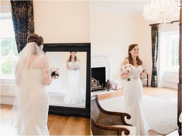 Botleys Mansion Weddings. A lace bridal gown and pink bow tie for the groom. Faye Cornhill fine art wedding photographer.