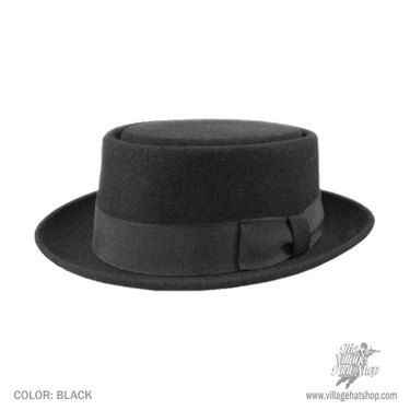 A 1940s-style porkpie hat. Stick a bit of peacock feather in the hat  band...maybe a more colorful hat band d921dff45
