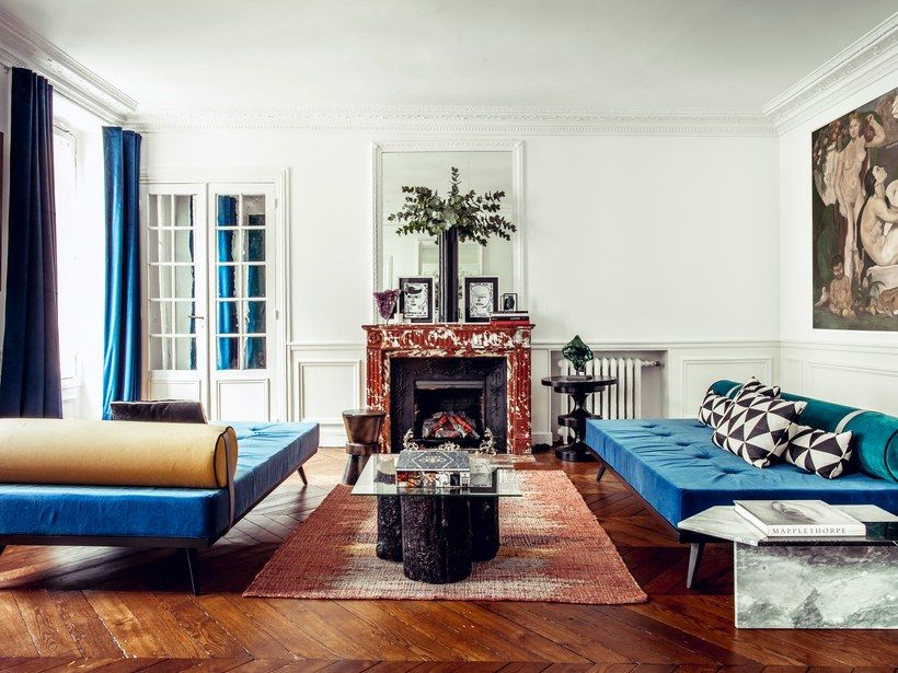 Hilary Swank recently tapped Axel Huynh, creative director of the 150-year-old French furniture company Henryot & Cie, to decorate her Paris apartment. The generously proportioned daybeds, designed by Axel Huynh for Henryot & Cie, flank a custom cocktail table, also created by Henryot & Cie, made from wood trunks sourced from the forest near the furniture maker's factory.