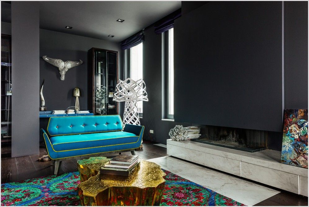 other metro black ceiling black column black wall blue sofa colorful area rug dark wood flooring. Black Bedroom Furniture Sets. Home Design Ideas