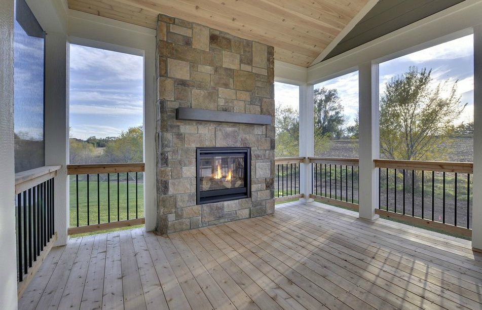 An Outdoor Fireplace On The Deck Perfect For Evening