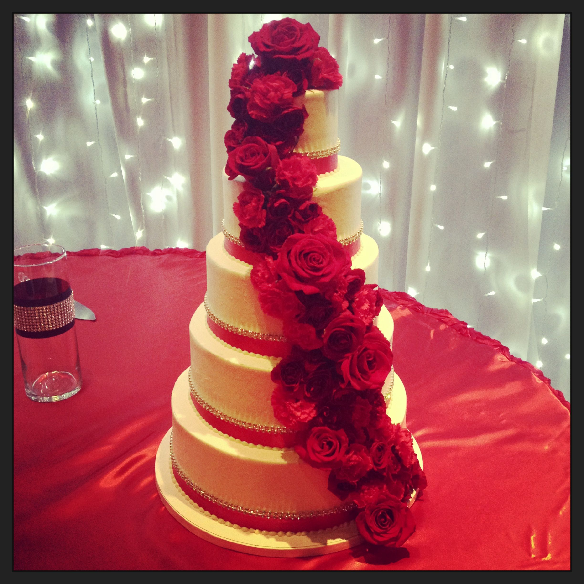 Buttercream wedding cake with diamond bling and fresh red