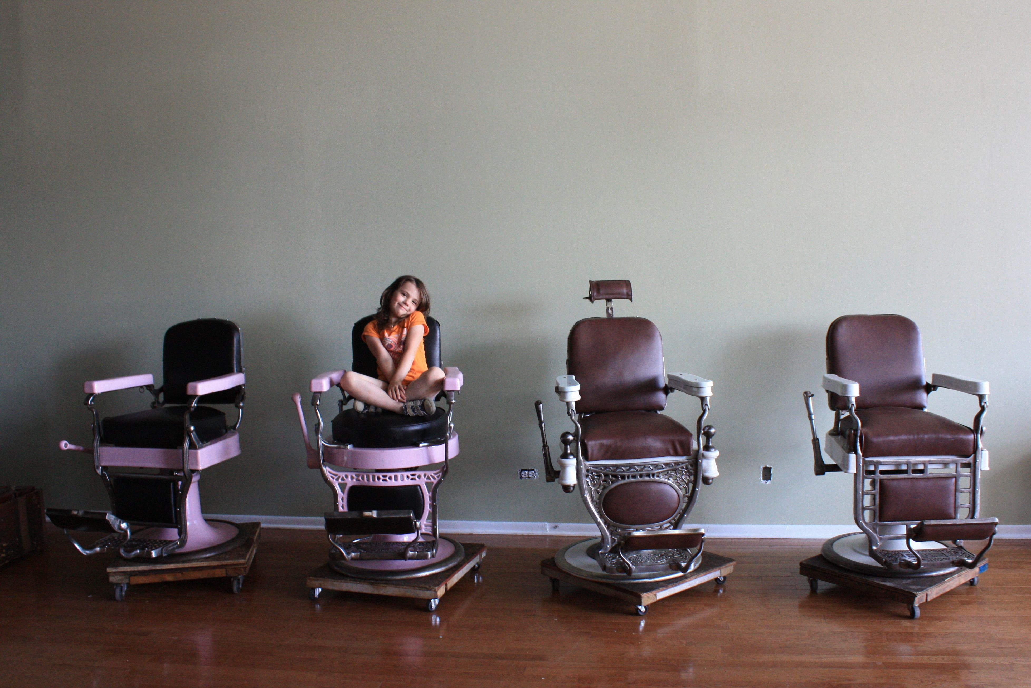 vintage barber chairs against grey wall