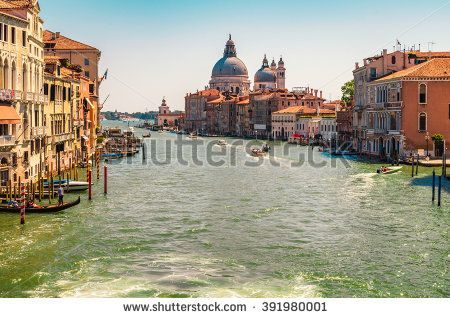 Facades of old houses in Venice - popular tourist destination of Europe