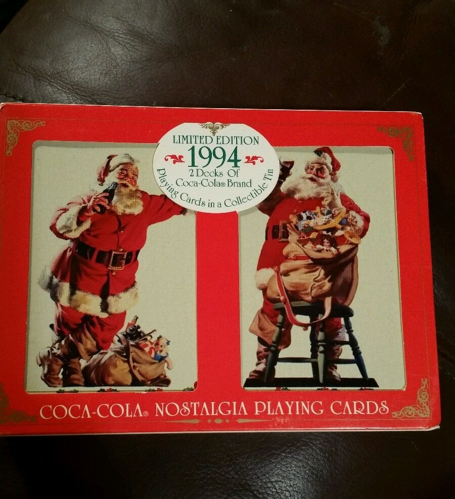 2 Decks of Coca-Cola cards in collectible tin. Limited edition Christmas Santa 1994 Coca-Cola playing cards. Tin made in England. Stickers on back of tin, possibly from an antique store.
