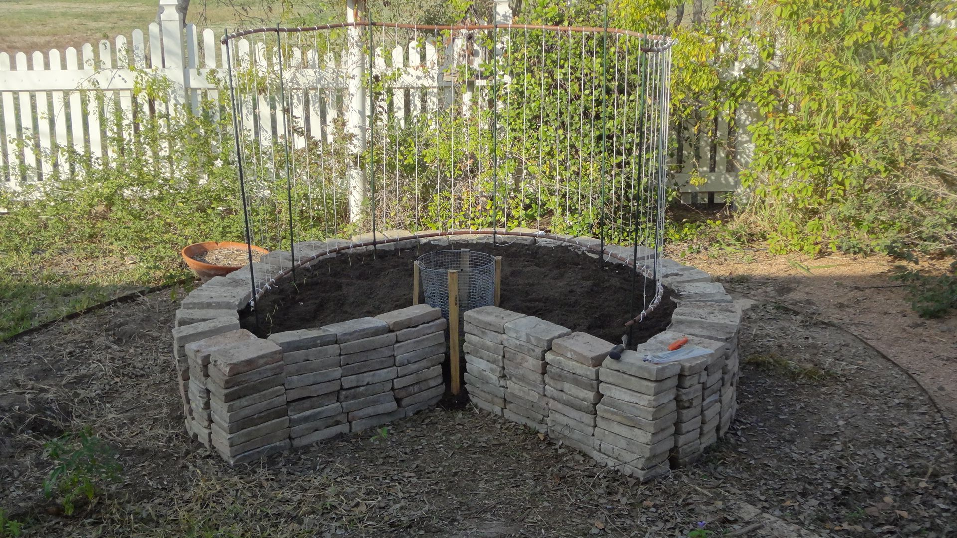 Keyhole Garden with pea trellis - design compliments of my husband