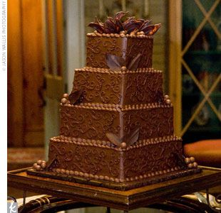 four-tiered chocolate groom's cake with chocolate leaves ...