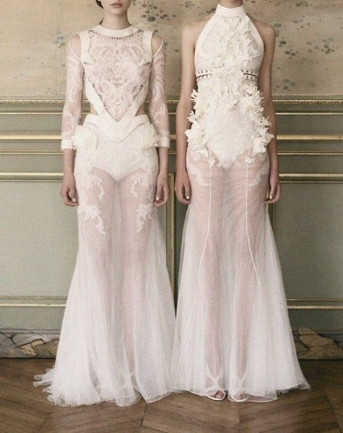 GIVENCHY netted dress, sown on flowers and embroidery. layered materials and opaque top fabric. 3D formal elements on top of the sheer material to create the look of natural objects growing on the dress, like vines growing on man-made creations.
