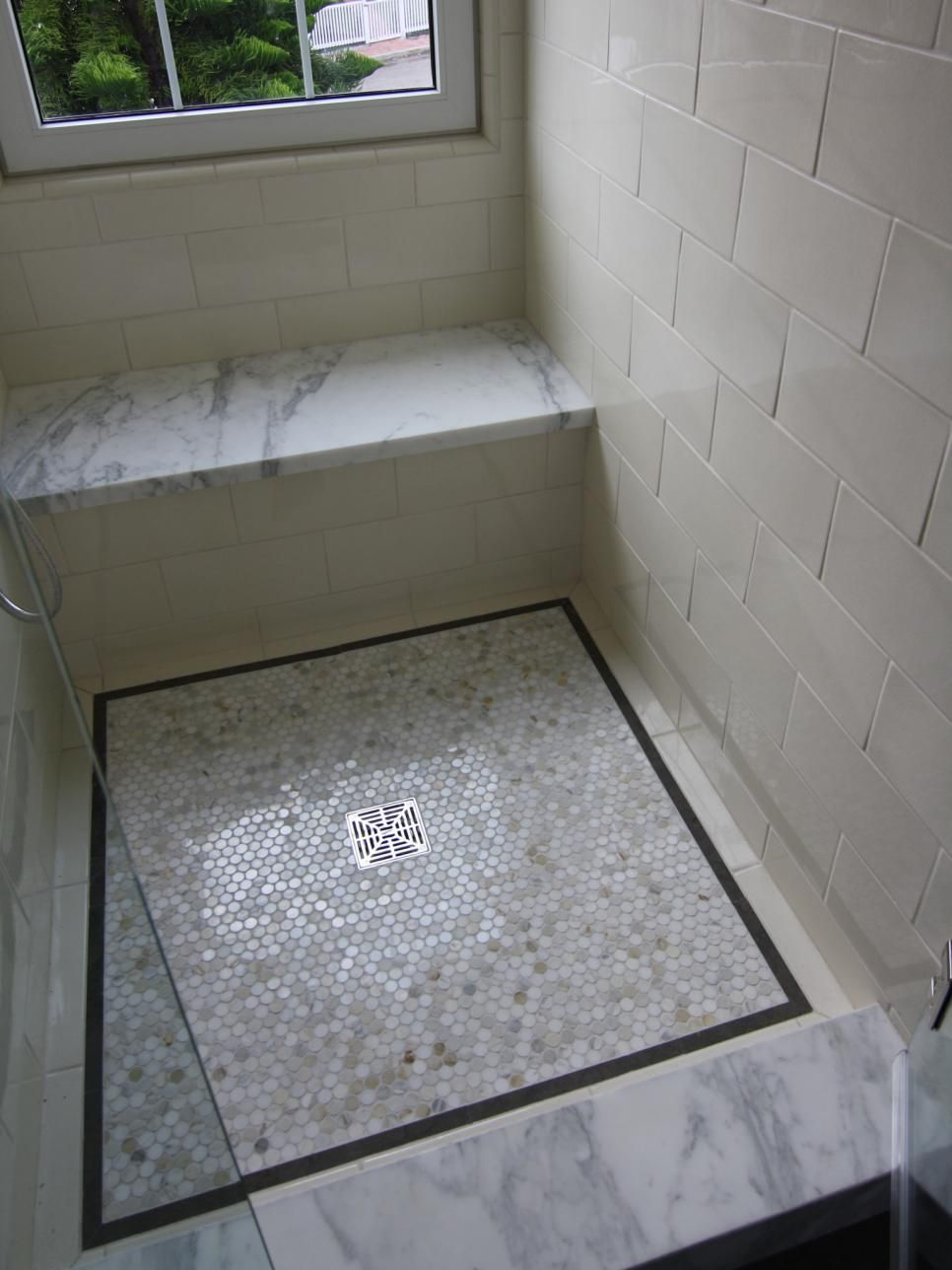 Marble Slabs On The Shower Bench And Curb Coordinate With
