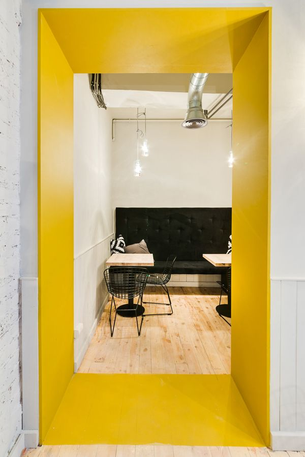yellow wall paint black sofa natural birch pavement café project by ...