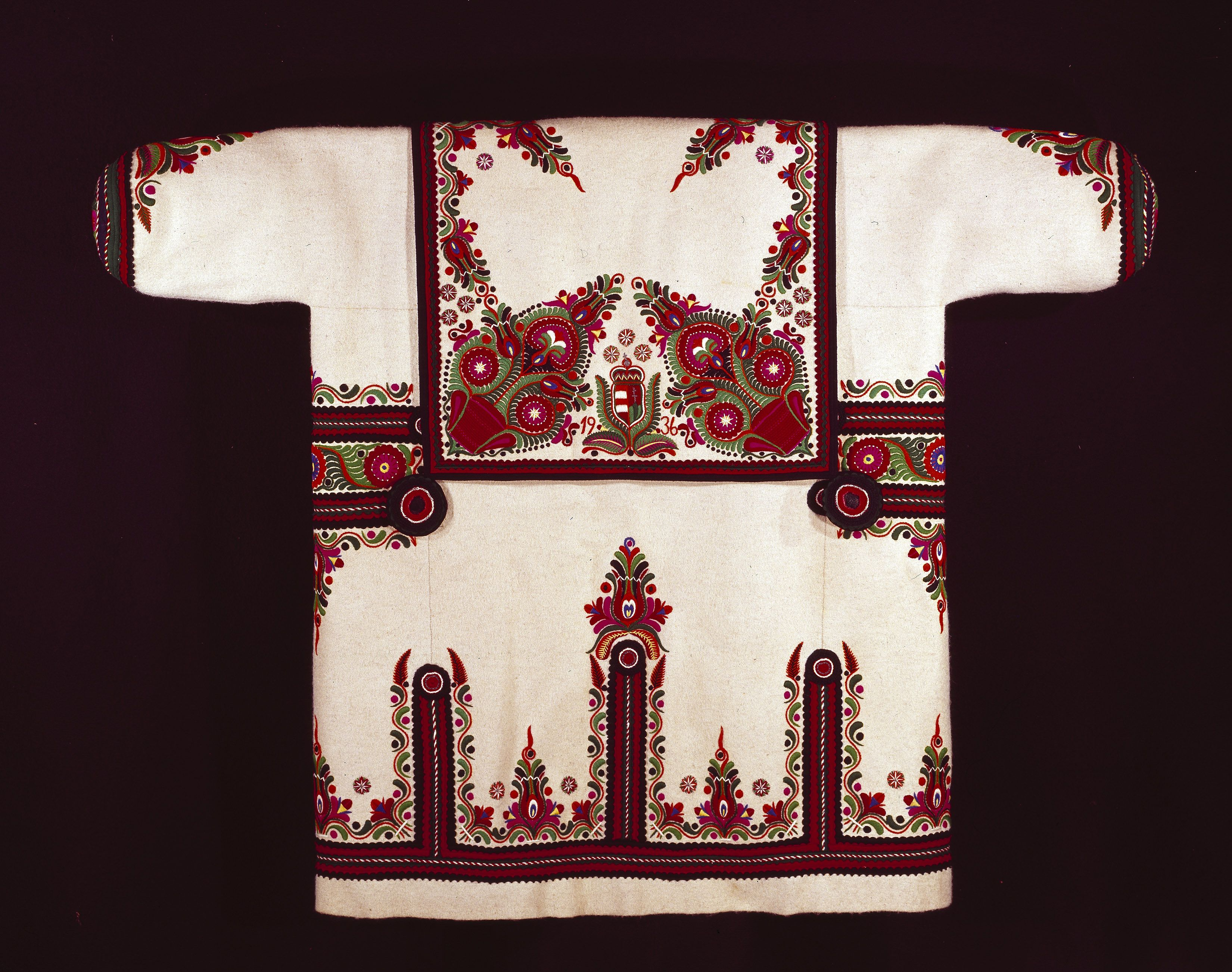 Man's szur or mantle Hungarian Fulled woollen twill with broad-cloth  edgings, embroidery and crochet roundels Centimetres: 120 (length) 1936  Area of Origin: ...