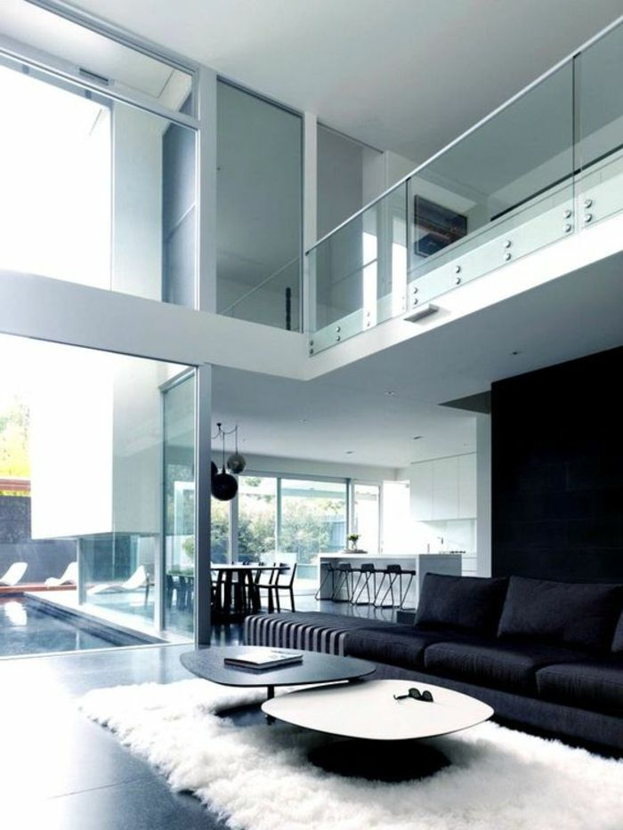 Decoraci n minimalista tonos claros sof negro dos pisos for Decoracion piso minimalista