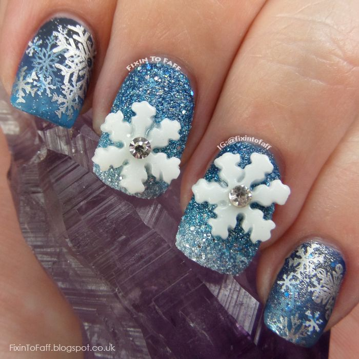 Snowflake nail art over blue gradient base with stamping and 3D nail ...