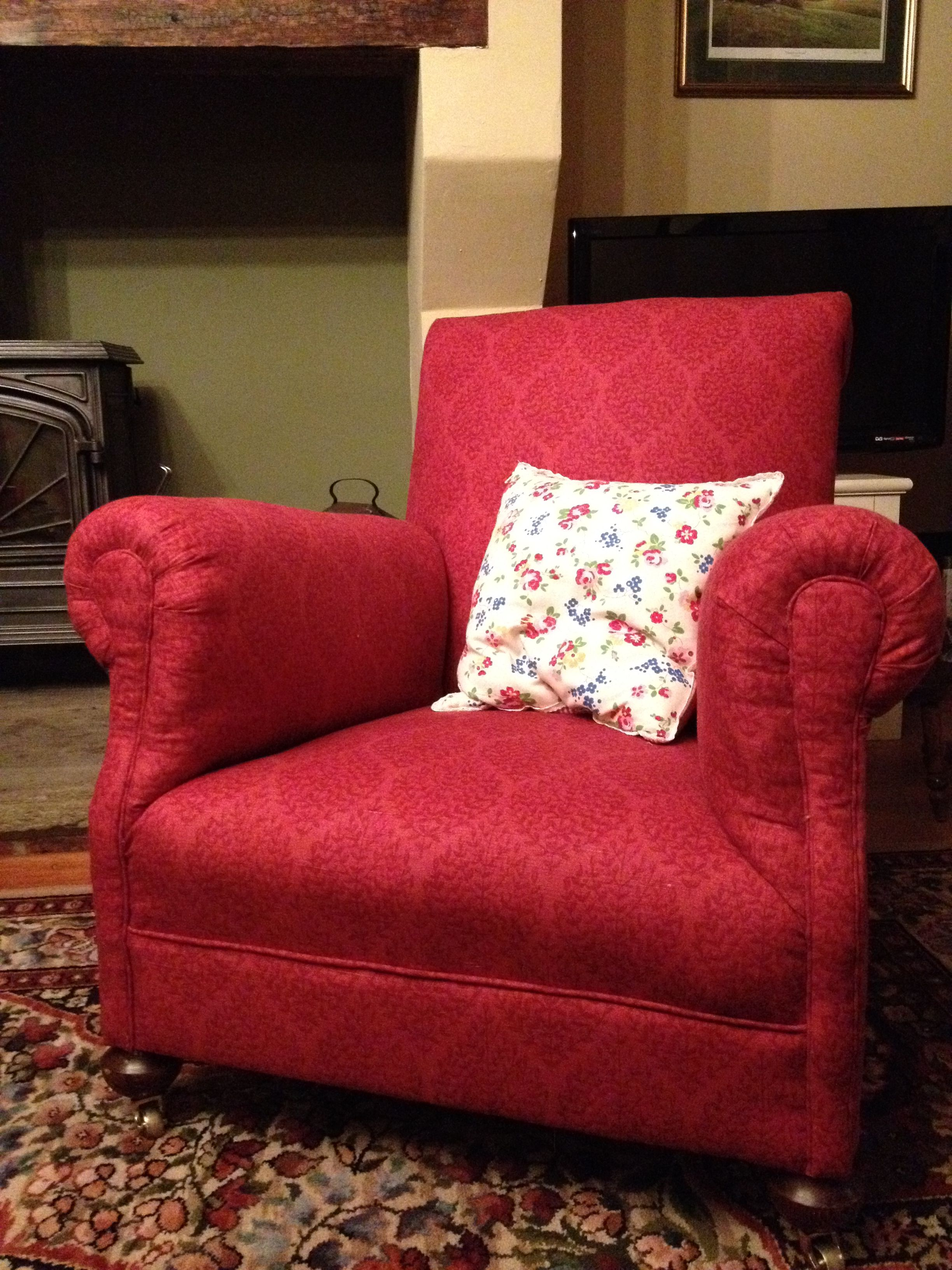 A cosy Victorian fireside armchair that I saved from the skip and reupholstered.