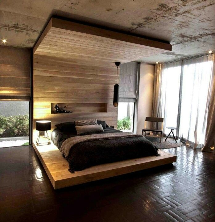 A beach house style bedroom, with a tropical, outdoor feel. The timber canopy helps to create and define an intimate space around the bed. Asymmetrical beside lamps hint at male/female balance.