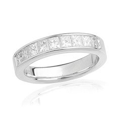 Give her an unforgettable ring to commemorate one of the most unforgettable moments of her life - your wedding day. Exquisitely crafted in sleek 14K white gold, this magnificent band features a line of sparkling princess-cut diamonds totaling 1-1/2 cts. channel-set along the shank. Polished to a brilliant shine, each time she glances at this lovely band, her thoughts will turn to you.