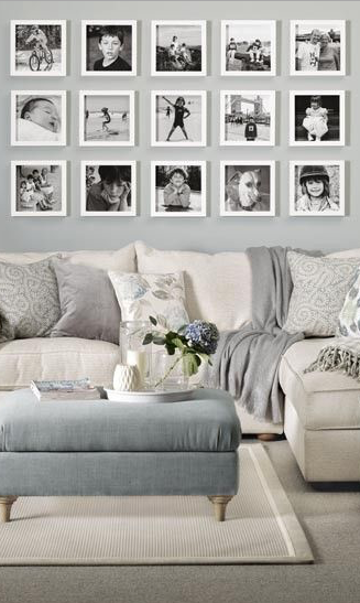 A Black And White Photo Wall Looks Perfect In This White And Grey