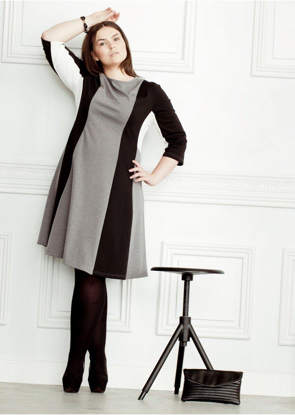 Schönes Kleid mit kontrastierenden Einsätzen und ausgestelltem Saum ... 91ea4f98ed