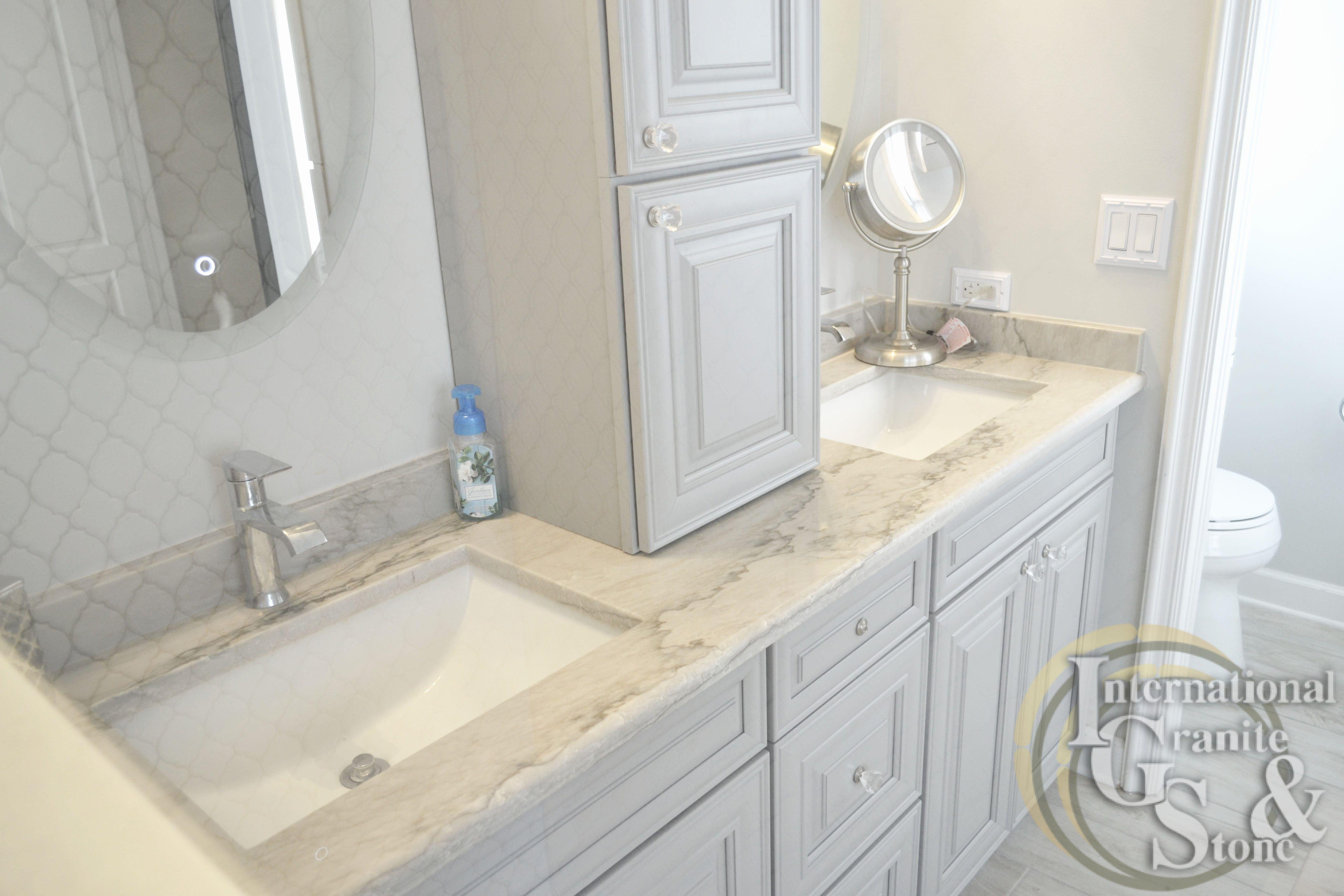 A Recent Calacatta Quartzite Master Bathroom Installation In Fort