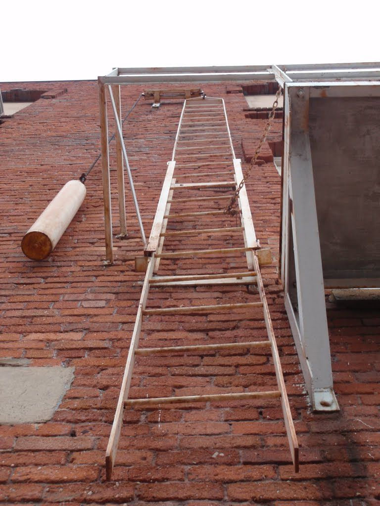 The Old Counterweighted Fire Escape Ladder On The Cabarrus Street