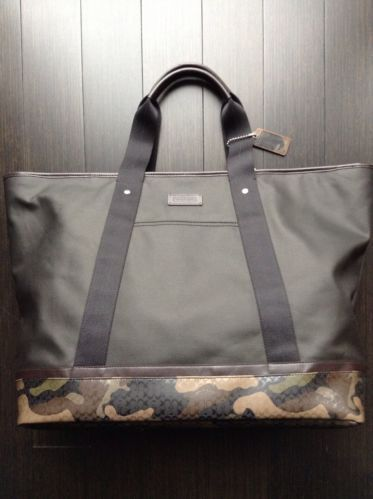 5d40ecd6e0 Coach men s black fatigue camouflage hze weekend tote bag new w tags ...