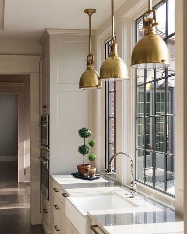 Modern kitchen with industrial golden lighting