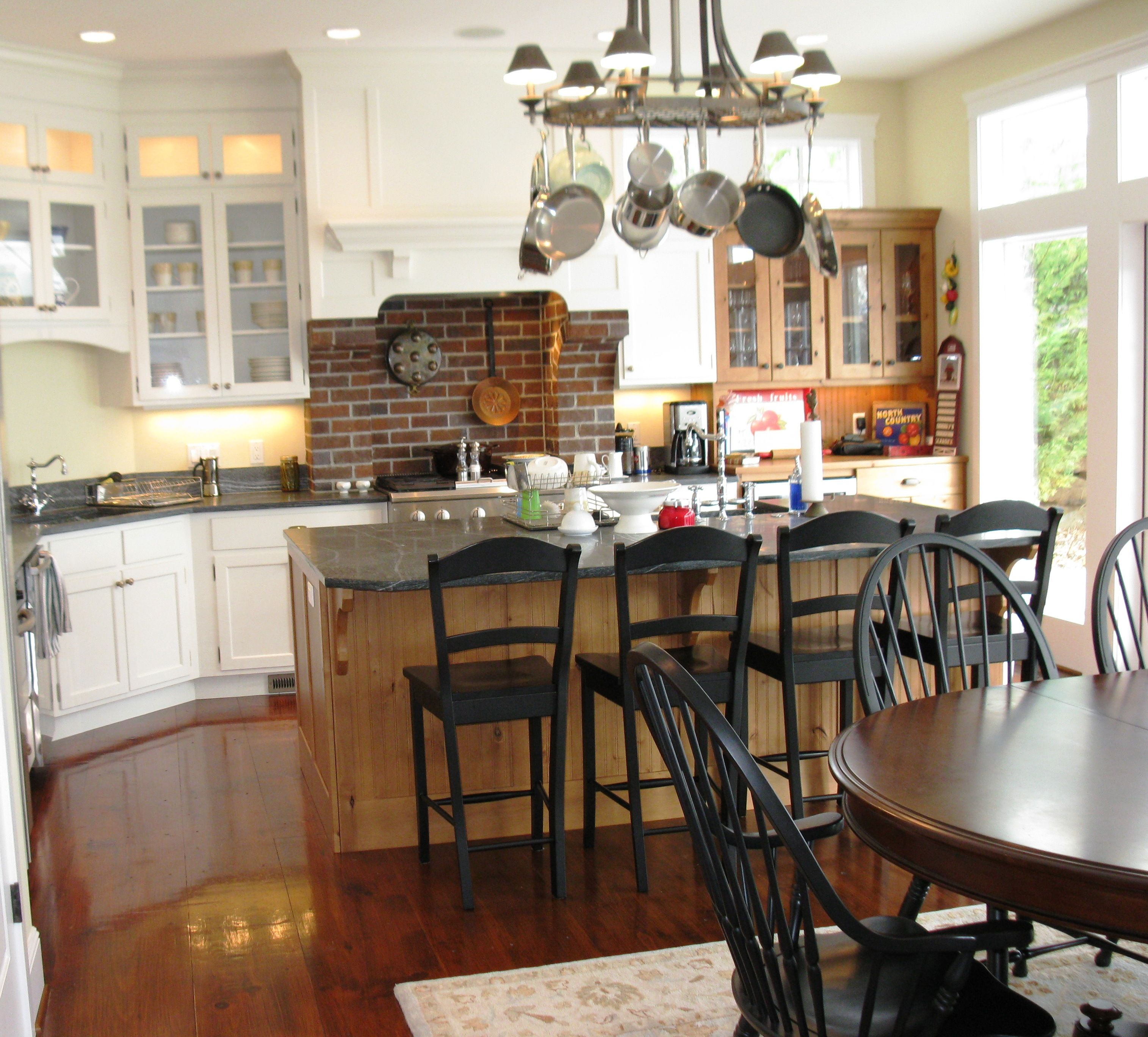Nantucket style kitchen with brick stove backsplash