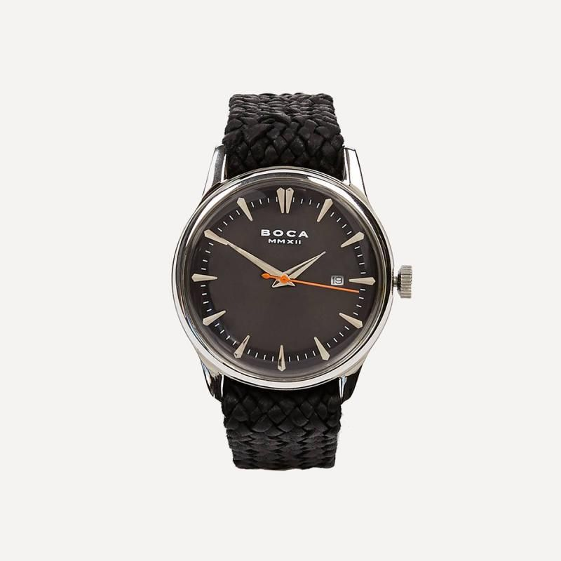 This BOCA MMXII watch has an abundance of quality and style. The simple design of this stainless steel watch gives this piece a timeless feel. The strap is handmade in Mexico using the finest quality sheepskin and calfskin. 39mm diameter, and 13.5mm thickness.
