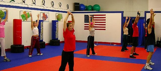 A cardio kickboxing class from the dojo I study/teach at in Westborough, MA. That's Carl Adams teaching the class.     This is great!