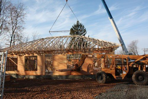 November 28th, 2012 - The construction crew has finished the wall frame, and are now putting the beams in place for the roof.   The crew is working as quickly as they can to get the roof up before more winter weather sets in.