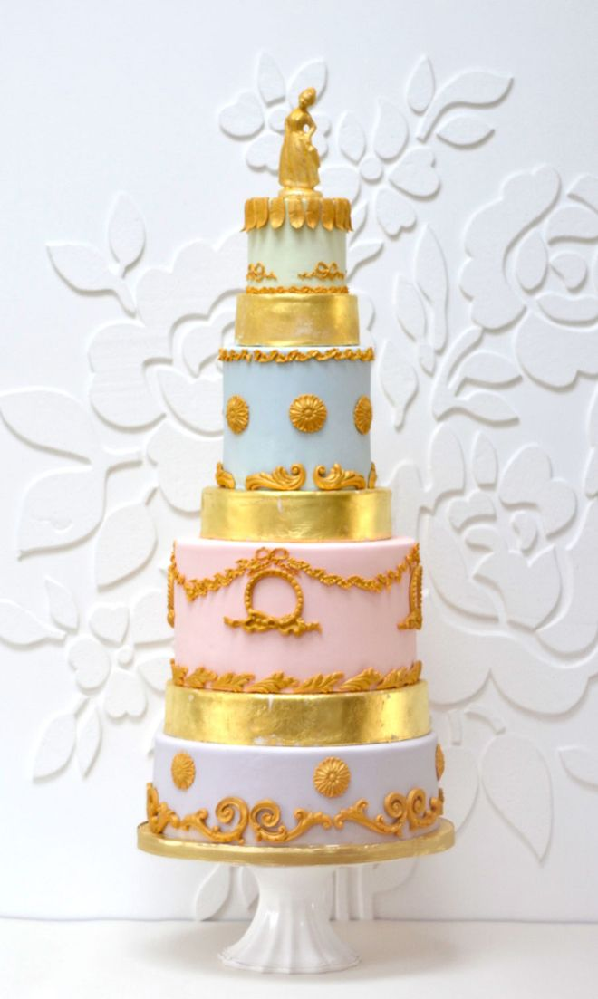 Metallic gold, light blue, and light pink wedding cake.